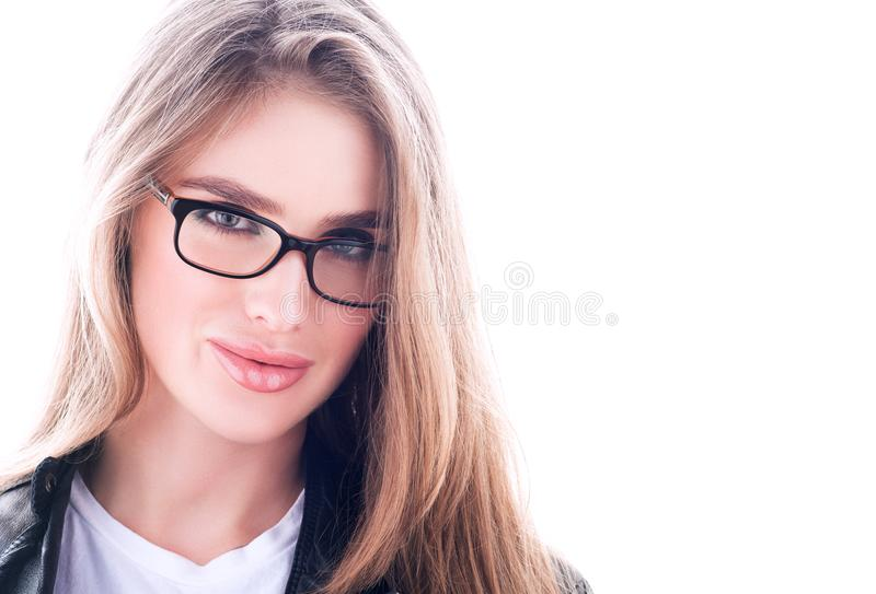 Portrait with free space. Young beautiful woman in glasses. Long flowing hair royalty free stock image