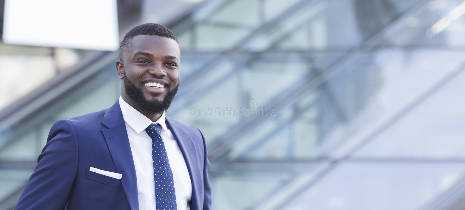 Cheerful Black Business Guy Smiling At Camera In Urban Area royalty free stock images