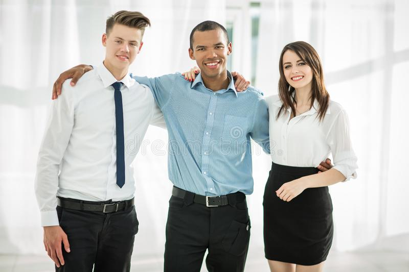 Portrait of friendly business team in the background of the office royalty free stock photography