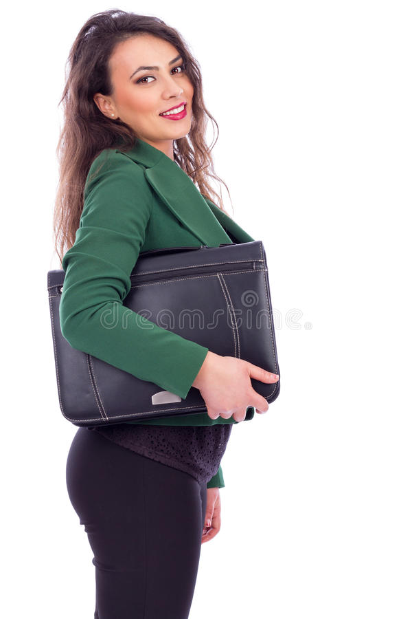 Portrait of a friendly businesswoman holding a briefcase stock photo