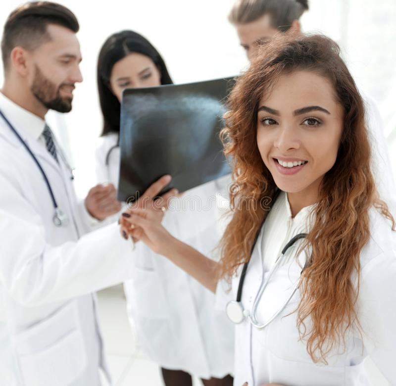 Confident doctors in hospital looking at x-ray. royalty free stock photography