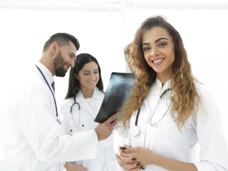 Confident doctors in hospital looking at x-ray. royalty free stock photo
