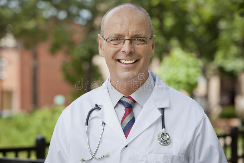 Portrait Of A Friendly Doctor Smiling At The Camera royalty free stock image