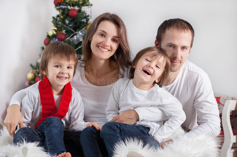 Portrait of friendly family looking at camera on Christmas evening royalty free stock images