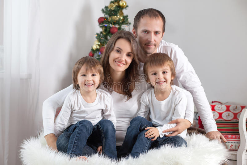 Portrait of friendly family looking at camera on Christmas evening royalty free stock photography