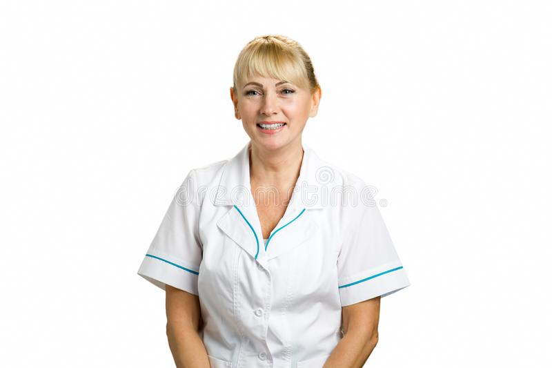 Portrait of friendly female doctor. royalty free stock photography