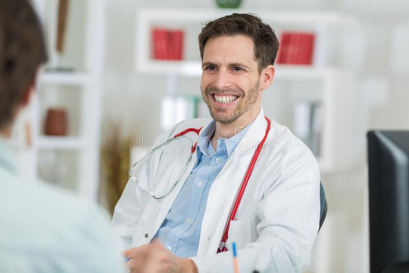 Portrait friendly male doctor smiling royalty free stock images