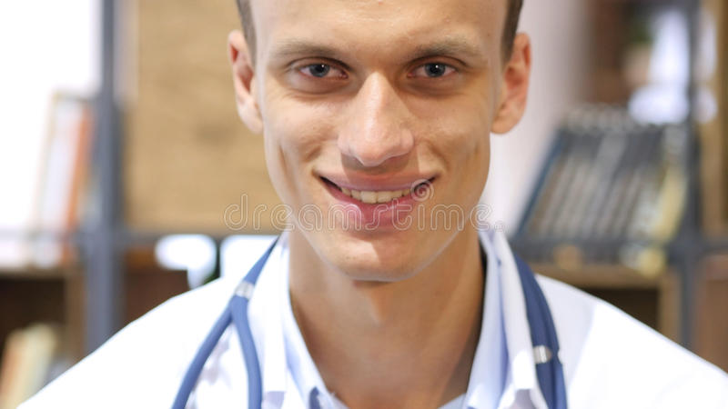 Portrait of friendly male doctor smiling in Clinic royalty free stock photos