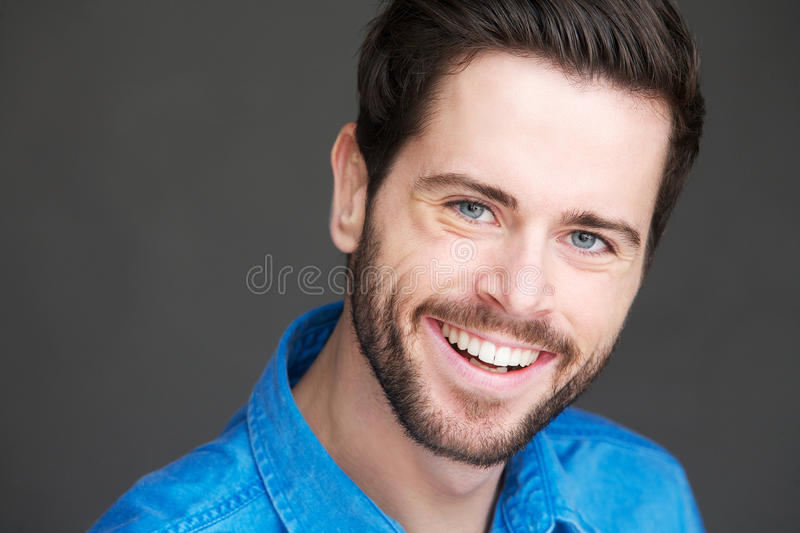Portrait Of A Friendly Young Man With Happy Expression Royalty Free Stock Photography