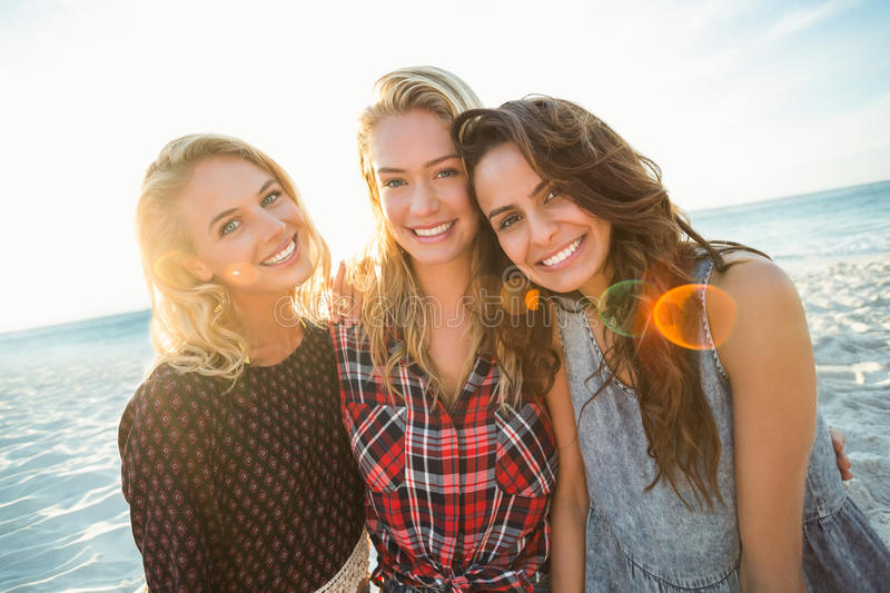 Portrait of friends on the beach stock images