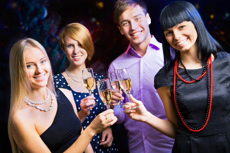 Portrait of friends celebrating New Year stock photography