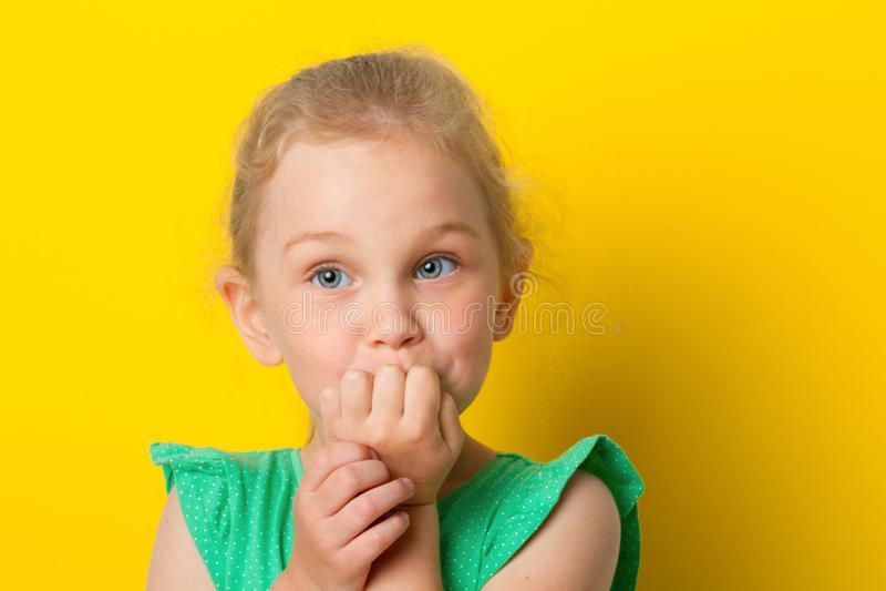 Girl looks shocked at camera. on white background. royalty free stock photos