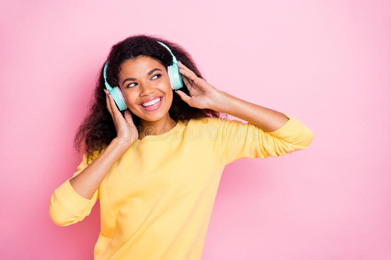 Portrait of funky cheerful african mulatto hipster youth girl have headset listen music song feel fun on break pause stock photography