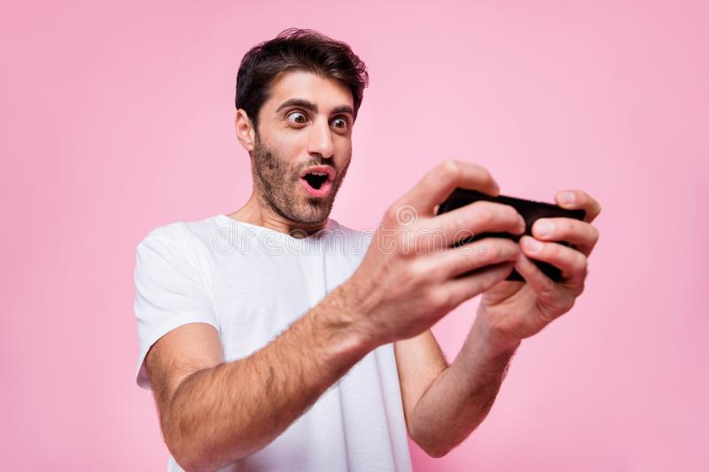 Portrait of funky funny arabian multiethnic guy use his cellphone find new video game play addicted player have fun wear royalty free stock images
