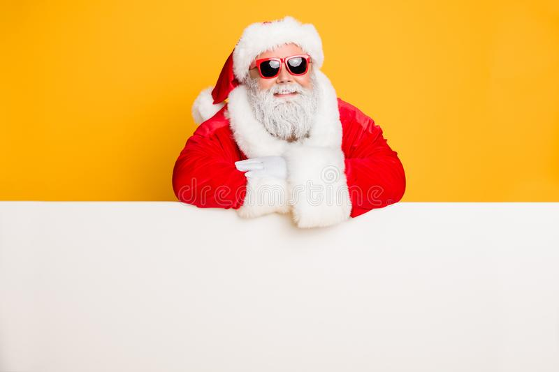 Portrait of funky funny santa claus put hands on white pure billboard advertise winter shopping season x-mas sales fairy royalty free stock photo