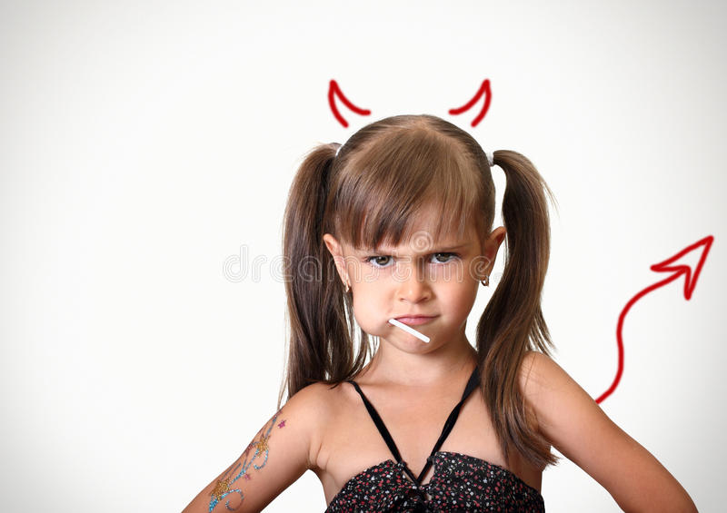 Portrait of funny angry child girl stock image