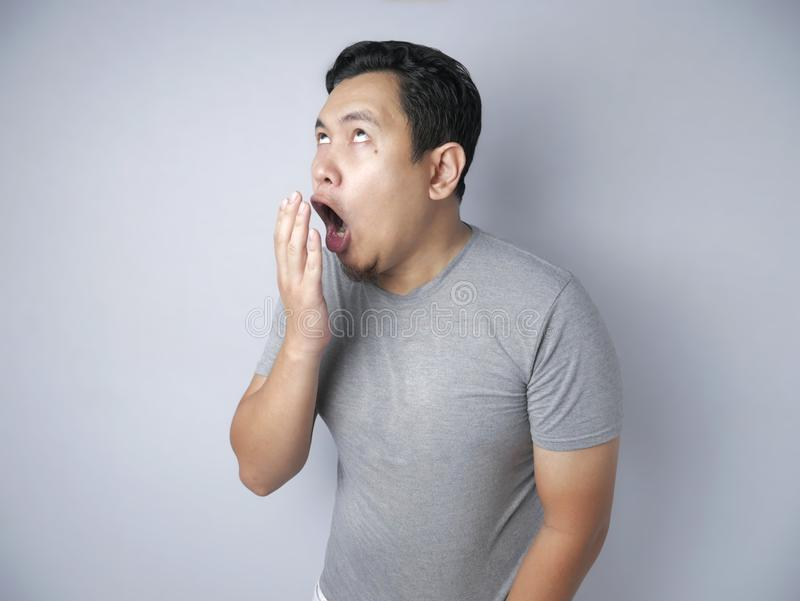 Funny Asian Man Check His Own Breath Smell stock photography