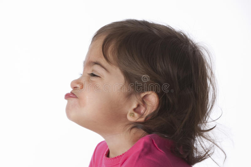 Portrait of a funny baby girl stock photo