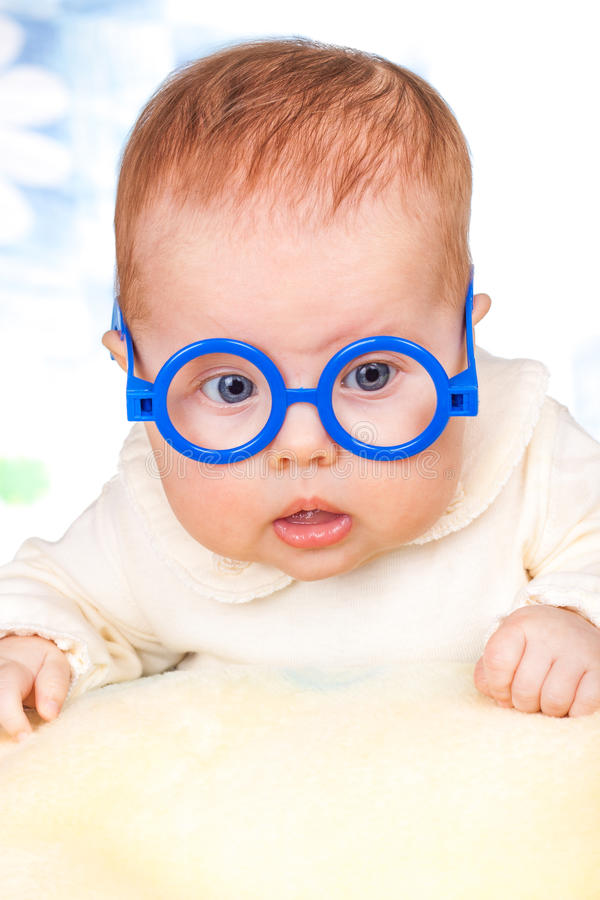 Portrait of funny baby with glasses stock images