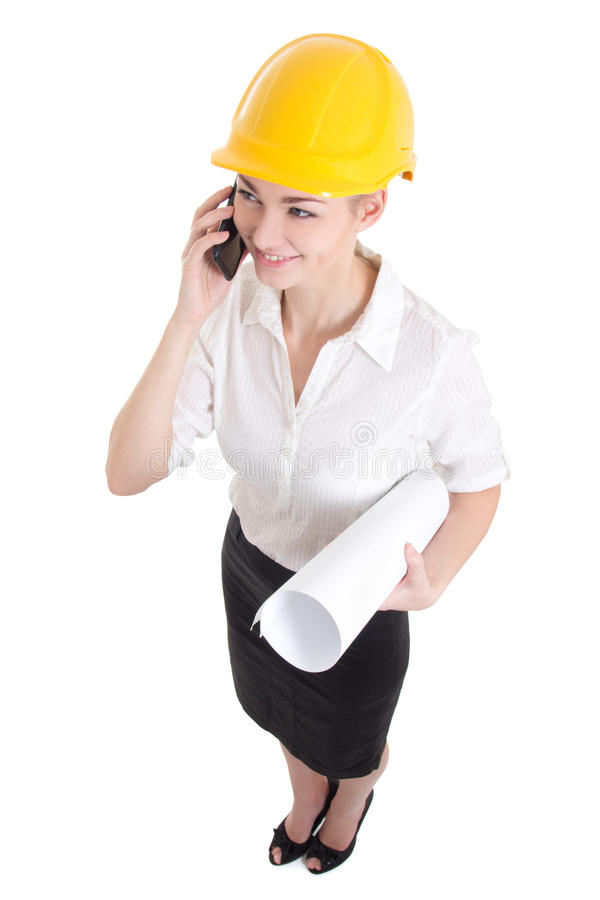 portrait of funny business woman architect in yellow builder helmet talking by phone isolated on white stock photography