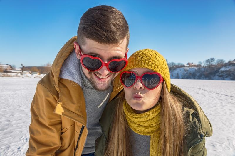 Portrait of funny and crazy couple in love. Laughing at the came royalty free stock photos