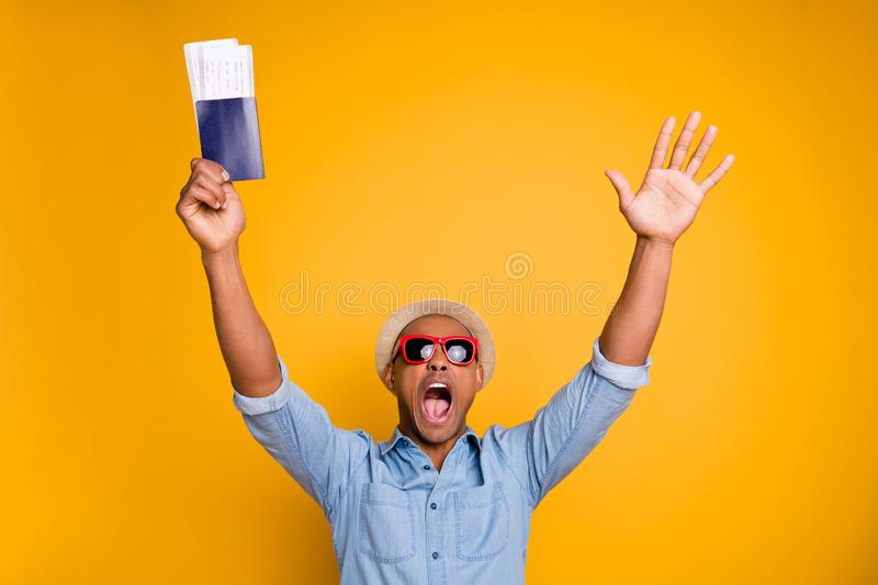 Portrait of funny cute passenger shout raise hands wear trendy stylish shirt denim jeans isolated over yellow background royalty free stock image