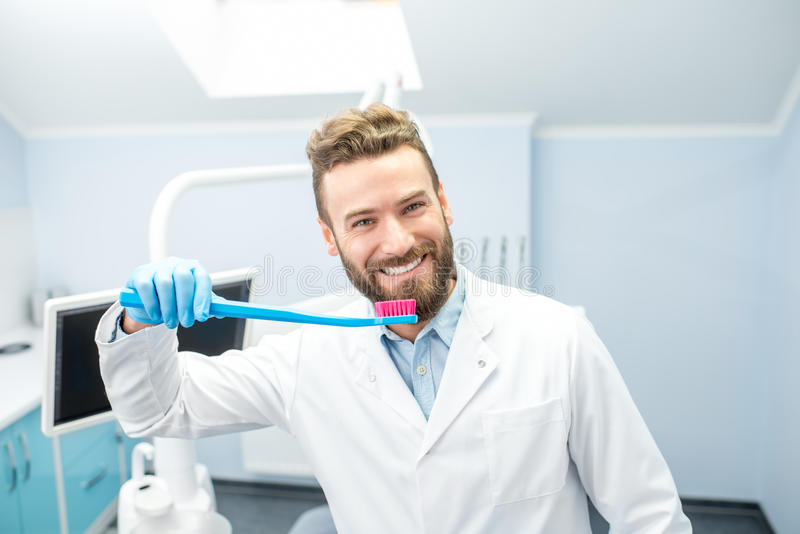 Portrait of funny dentist royalty free stock image