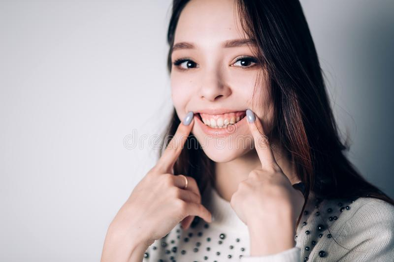 Portrait of funny emotional girl. happiness, smile, positive emotions. Portrait of funny emotional girl on white background. happiness, smile, positive emotions royalty free stock photo