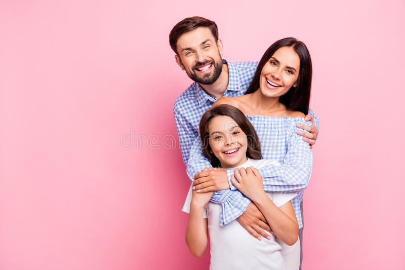 Portrait of funny family laughing wearing plaid shirts off-shoulders white t-shirt isolated over pink background royalty free stock photography