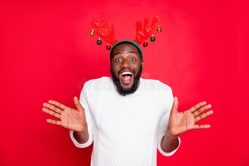 Portrait of funny funky brown hair afro american guy scream wow omg hear incredible news about christmas time season. Portrait of funny funky brown hair afro royalty free stock photo