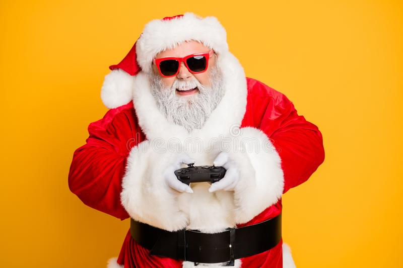 Portrait of funny funky crazy santa claus play videogame on newyear holly noel celebration have excited entertainment royalty free stock images