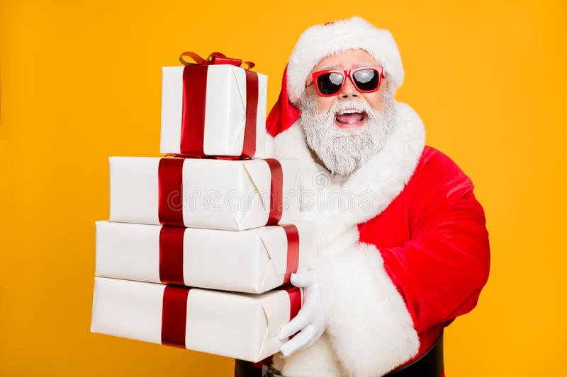 Portrait of funny funky grey hair santa claus in red hat hold packages he brings for good kids people celebrate newyear royalty free stock photo