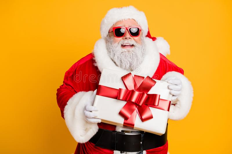 Portrait of funny funky santa claus hold christmas package for good kids he sends on x-mas night celebration isolated stock photos