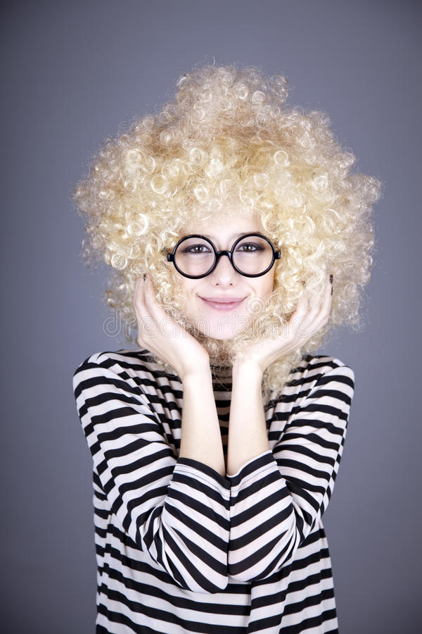 Portrait of funny girl in blonde wig. stock images