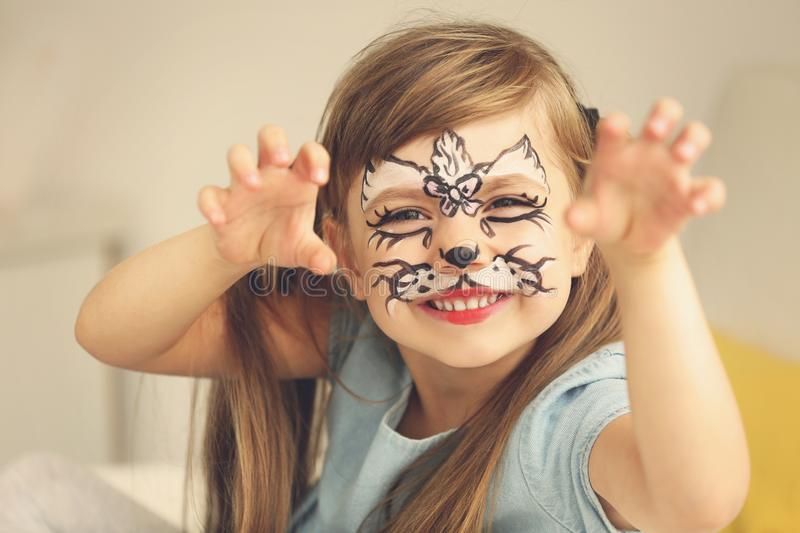 Portrait of funny girl with face painting on background. Portrait of funny girl with face painting on blurred background royalty free stock photo