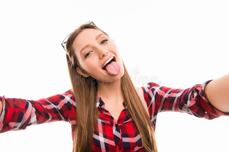Portrait of funny girl grimacing and making selfie stock photo