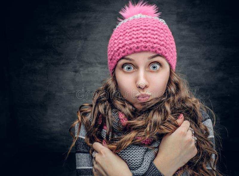 A girl in winter hat with wonder on her face. royalty free stock photography