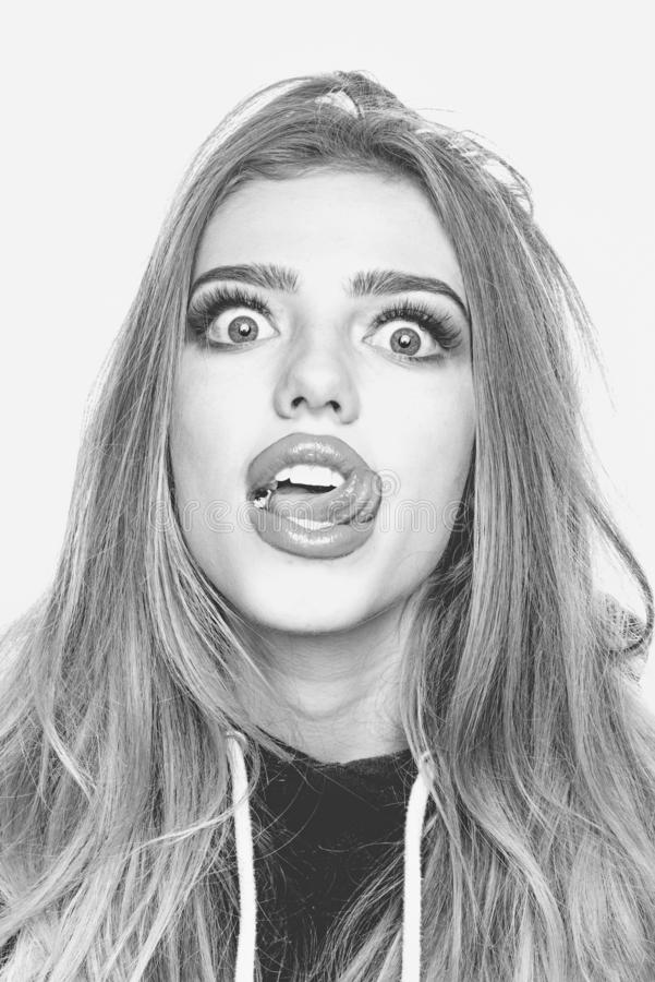 Portrait of a funny hipster girl looking at camera over white background. Comic woman. Close up portrait of surprised stock image
