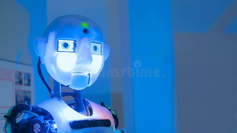 Funny humanoid robot. Portrait of funny humanoid robot at technology exhibition. Future and robotic concept stock photos