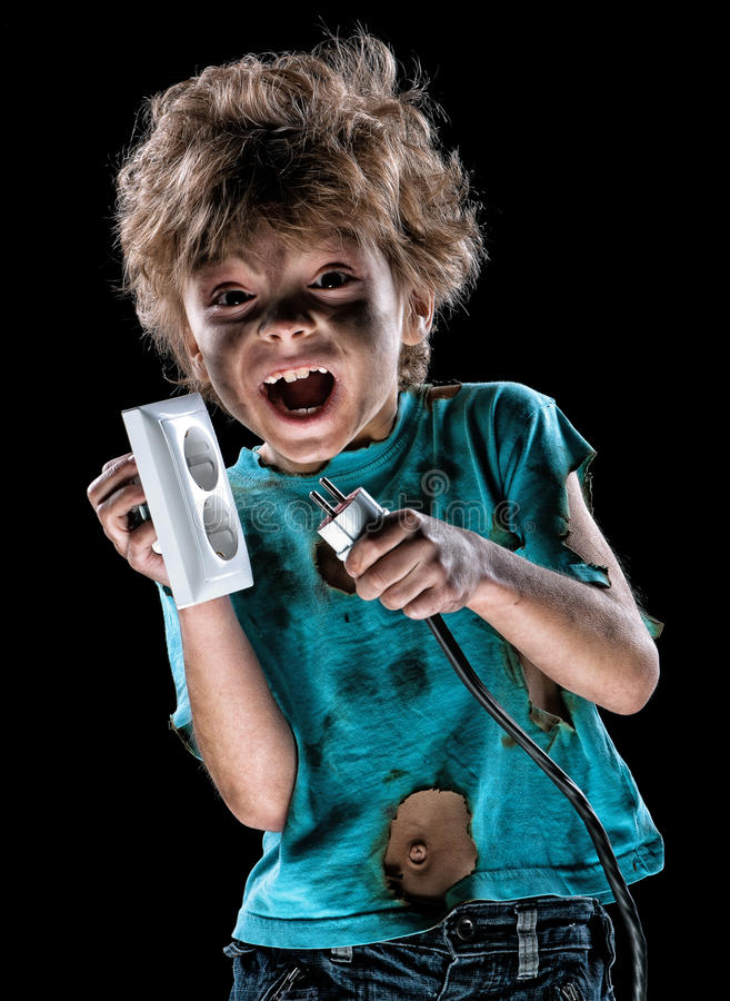 Portrait of funny little electrician. Over black background stock image