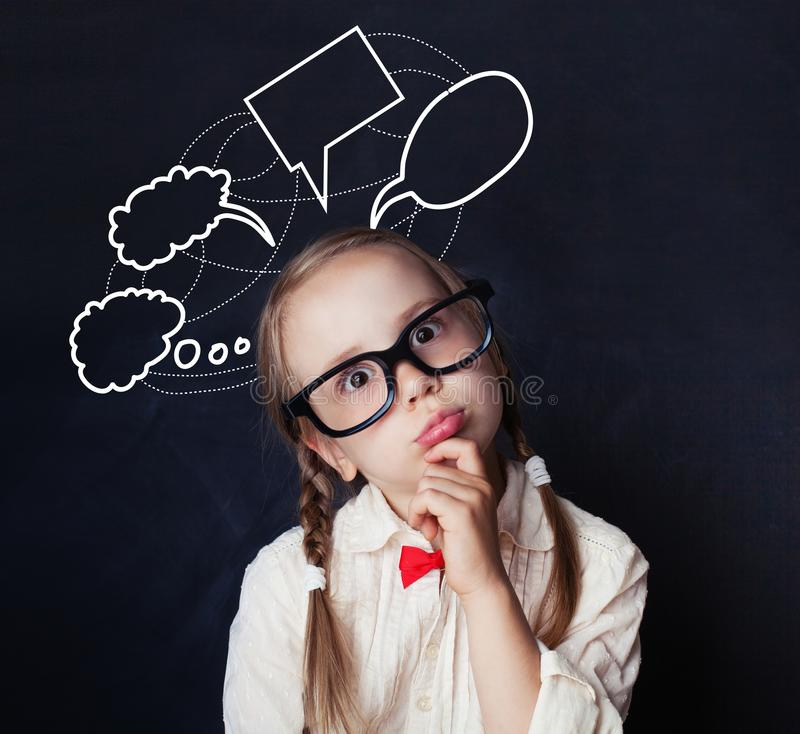 Portrait of funny little girl with empty speech clouds chalk royalty free stock photos