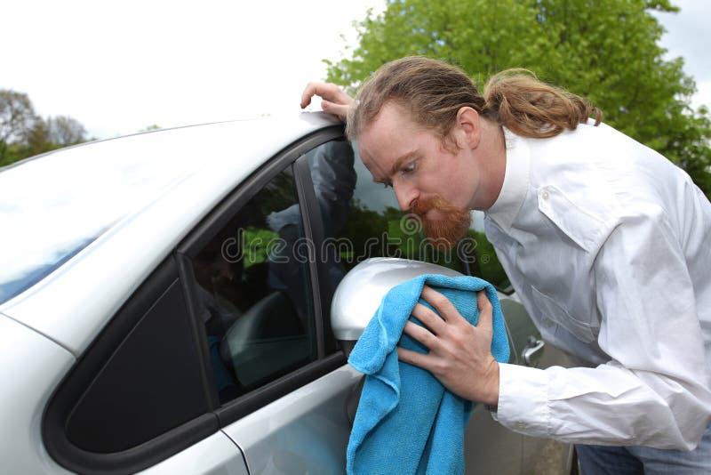 Portrait of funny man washing car royalty free stock photos