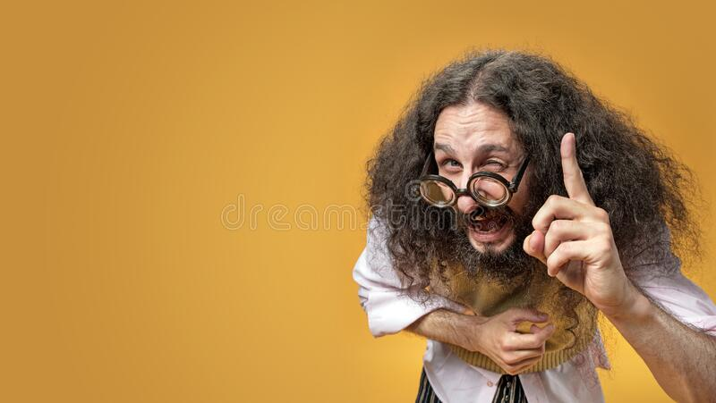 Portrait of a funny nerd wearing funny glasses royalty free stock images