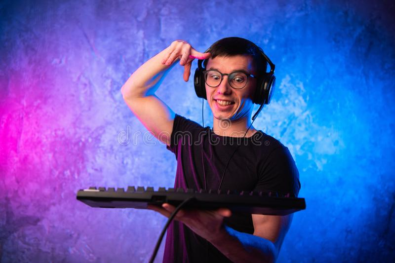 Portrait of funny nerd working on computer.  stock image