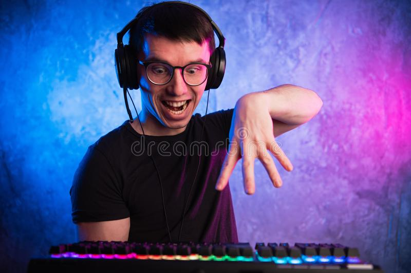 Portrait of funny nerd working on computer.  stock photography