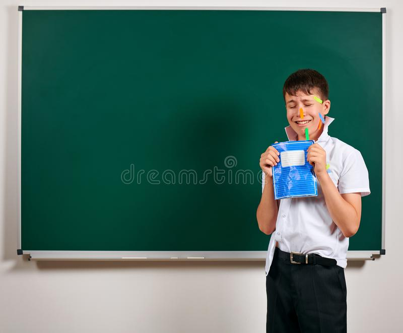Portrait of funny pupil. School boy very emotional, having fun and very happy, blackboard background - back to school and. Education concept stock images