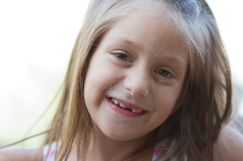 Portrait of funny toothless little girl stock photo