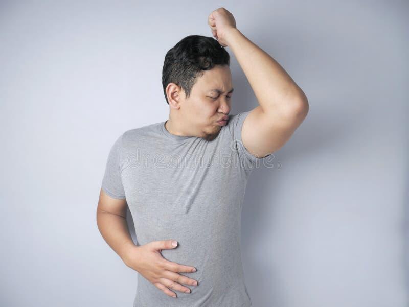 Man Having Bad Body Odor royalty free stock image
