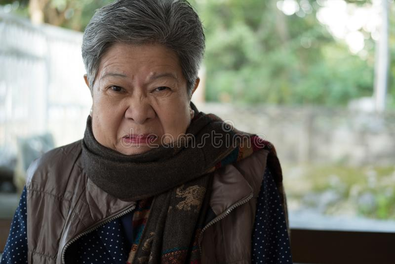 Portrait of furious elder woman, enraged elderly female, angry s. Portrait of furious elder woman, enraged elderly female, angry asian senior stock image