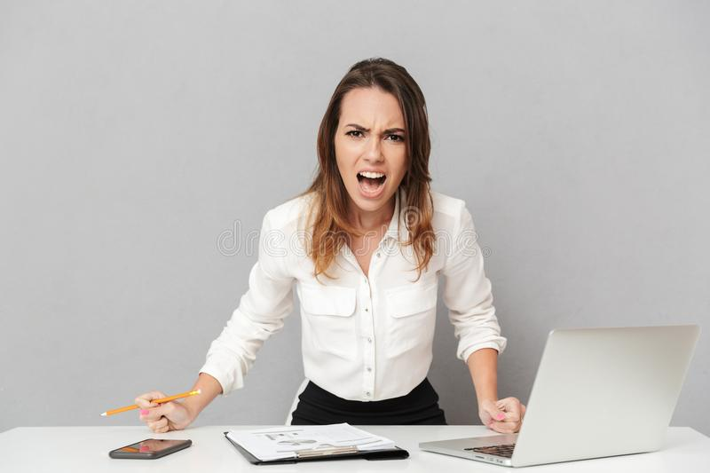Portrait of a furious young business woman stock image